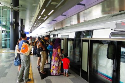 Commuters boarding the MRT train at Semantan station