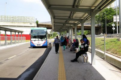 Commuters waiting for bus at the feeder bus hub.