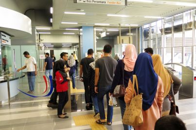 Commuters exiting the Bandar Utama station
