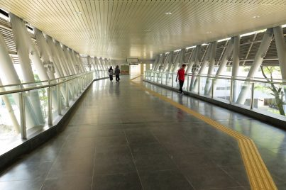 Pedestrian link bridges connecting the entrances of the station with neighboring buildings