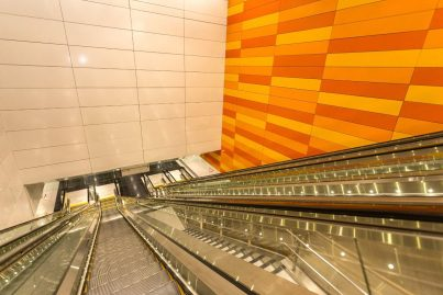 Escalator and stair access between levels at Cohrane station