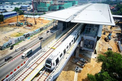 Aerial view of the trains undergoing testing on the completed guideway leaving the Kampung Selamat station. Apr 2016