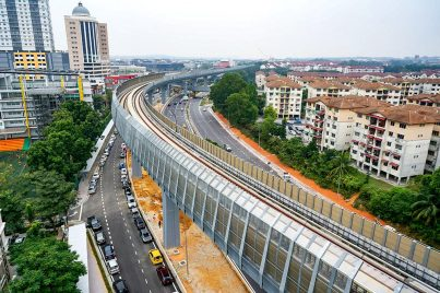 The guideway heading out of the Kota Damansara Station with sound barriers installed. Nov 2016