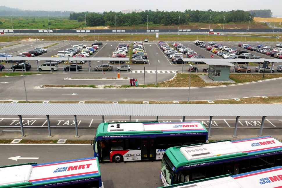 Buses and cars parking at Kwasa Sentra station's park and ride area