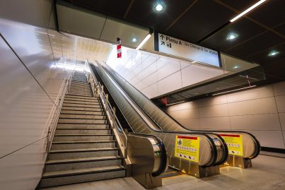 Escalators and stair for access to the ground level, heading towards Entrance A