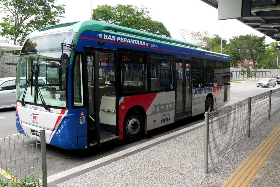 MRT feeder bus waiting at bus stop near Entrance B