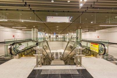 Escalator access to the train boarding platforms