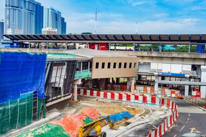 View of the pedestrian link bridge connecting the MRT and KTM Pasar Seni Stations undergoing construction.