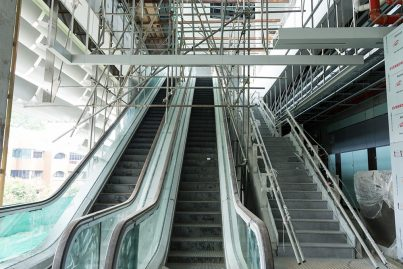 The escalators that lead up to the platform level of the Pusat Bandar Damansara Station.