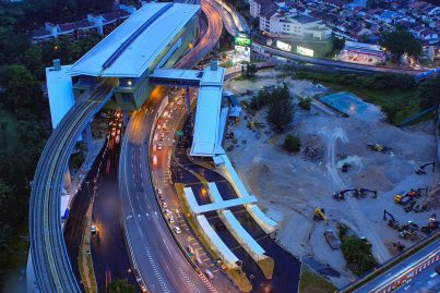 Evening aerial view of the Pusat Bandar Damansara Station and the lay-bys for feeder buses, taxis and private cars to drop-off and pick-up MRT commuters. Sep 2016