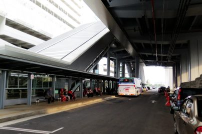 Feeder bus waiting near entrance A of station