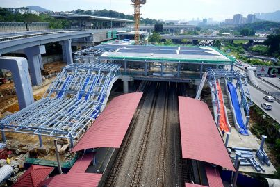 The common concourse of the Sungai Buloh KTM Station (red roof) and the Sungai Buloh MRT Station (left) taking shape. Jan 2016