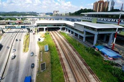 View of the completed Sungai Buloh MRT Station with the common concourse with the Sungai Buloh KTM Station over the KTM tracks. Also seen is an MRT train undergoing testing. Nov 2016