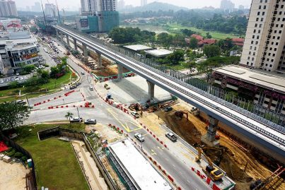 Aerial view of the MRT guideway with the construction of the Persiaran Mahagoni intersection underpass in progress. Oct 2015