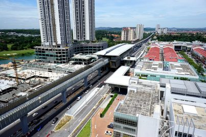 View of the completed Surian Station with its pedestrian link bridge to the adjacent buildings being constructed. Sep 2016