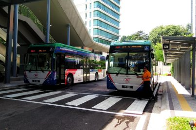 Shuttle buses waiting at bus stop near entrance A