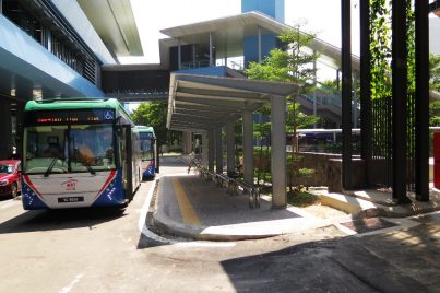 Shuttle bus waiting at bus stop near entrance A