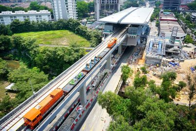 Locomotives transporting equipment on the completed guideway heading towards the Taman Tun Dr Ismail Stat Apr 2016