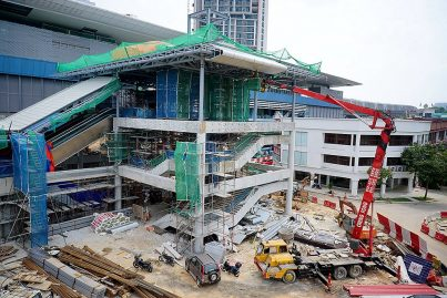 Roofing of the entrance of the Taman Tun Dr Ismail Station in progress. Jul 2016