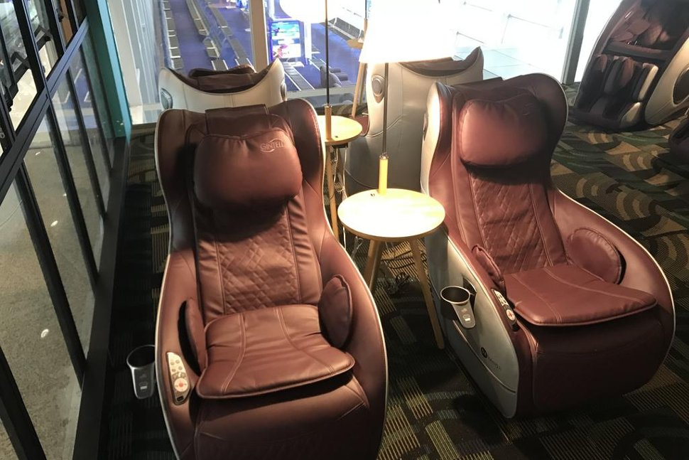 Recharge yourself at the comfortable massage chair before your flight